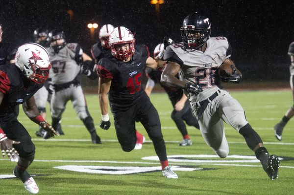 Euless Trinity clinches District 7-6A with 49-14 lightning delayed win over Coppell